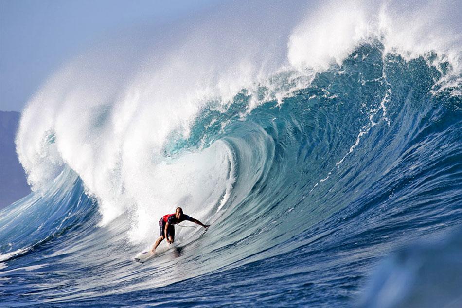 man surfing the Banzai Pipeline