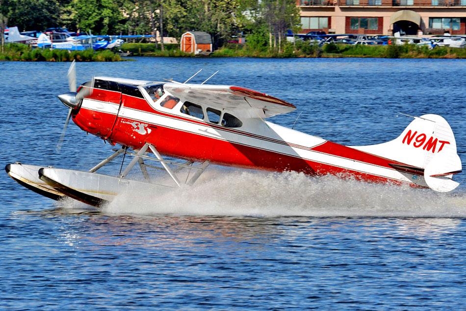 Float plane landing on water