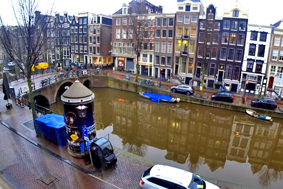 canal and street in amsterdam